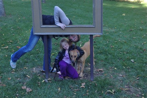 Mom, daughter and dog with picture frame