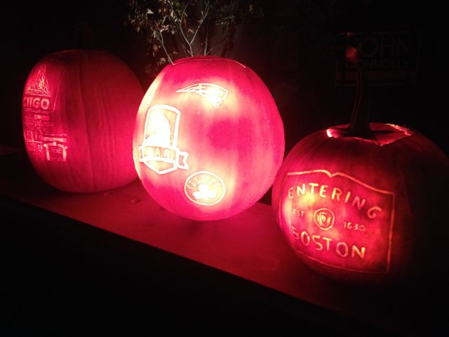 Photo of pumpkins carved with Boston images