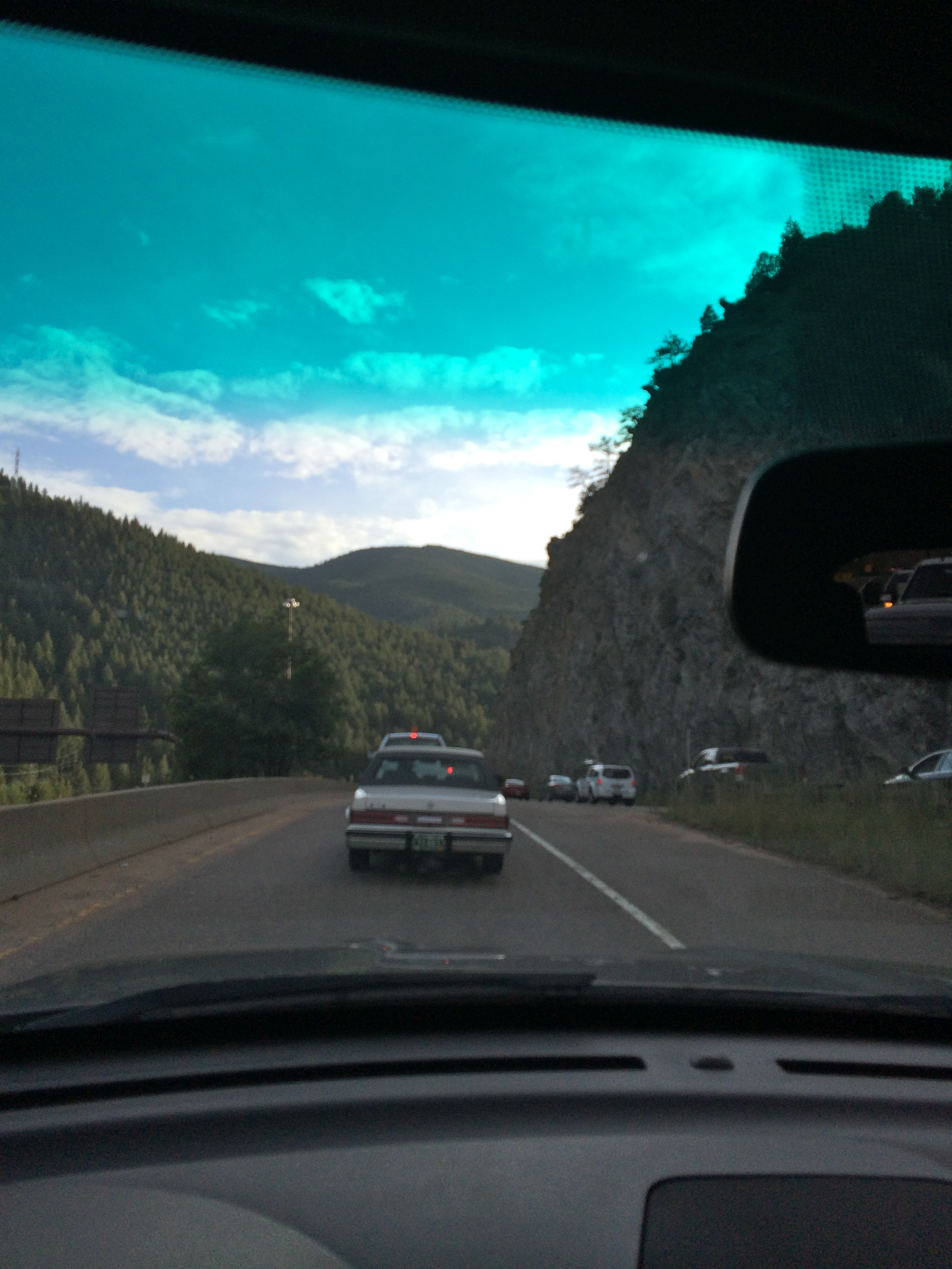 View of mountains through car windsheild