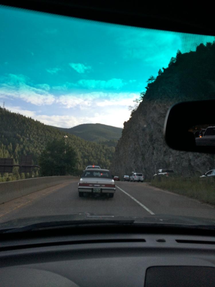 View of mountains through car windsheild