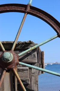 Part of a rusty ship's wheel