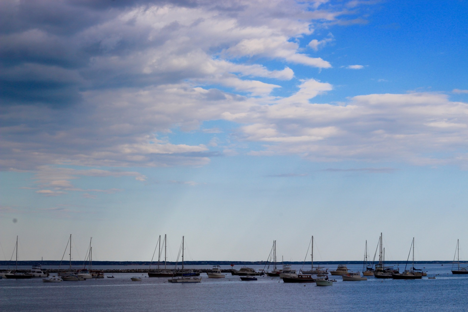 boats on the ocean with pretty sky