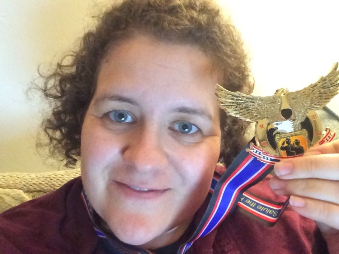 Jodi with running medal